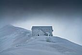Rifugio Duca degli Abruzzi covered with ice, Campo Imperatore, L'Aquila province, Abruzzo, Italy, Europe