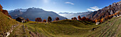 Panoramic picture of the village of Dasile in autumn, with Valchiavenna mountains in the background, Province of Sondrio, Lombardy, Italy