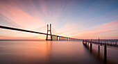 Sunrise colors in Tagus River and frame the Vasco da Gama bridge in Lisbon Portugal Europe