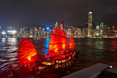 Traditional Chinese junk boat for tourists on Victoria Harbour illuminated at night, Hong Kong, China, Asia
