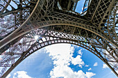 Sunbeams through metal beams of Eiffel Tower, Paris, Ile de France, France