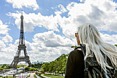 Caucasian woman admiring scenic view of Eiffel Tower