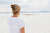 Caucasian woman admiring scenic view of desert