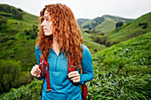 Caucasian woman hiking with backpack
