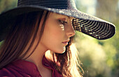 Close up of pensive Caucasian teenage girl wearing hat