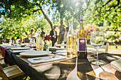 Wine bottles on table at party outdoors