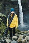 Caucasian woman walking near waterfall