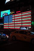 Illuminated US flag at Times Square of US Army Recruiting building, Manhattan, NYC, New York City, United States of America, USA, North America