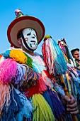 Man in traditional costume at La Vijanera Carnival. Silio. Molledo Municipality, Cantabria, Spain