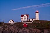 USA, Maine, York, Nubble Light Lighthouse, dusk.