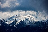 Snow storm moving in on the snow capped Olympic Mountains in the U.S.