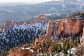 Winter scene in a wide landscape image of Bryce Canyon.