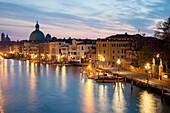 Dawn on Grand Canal in Venice, Italy. San Simeone Piccolo church dome in the distance.
