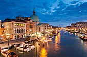 Night falls on Grand Canal in Venice, Italy. San Simeone Piccolo church dome towers above Santa Croce district.