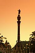 Barcelona, Columbus Monument, Passeig Maritime, sunset