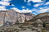 Weathered Buddhist chortens at Neyrak village looking over cliff, Zanskar, India, Himalayas, Asia