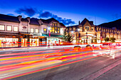 Trail lights and shops on Banff Avenue at dusk, Banff, Banff National Park, Alberta, Canada, North America