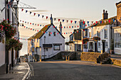 View along Broad Street at sunrise, Lyme Regis, Dorset, England, United Kingdom, Europe