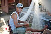 Vietnamese fisherman mending a net, Quang Nam, Vietnam, Indochina, Southeast Asia, Asia