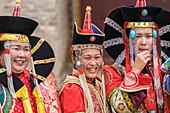 Three women wearing traditional Mongolian costumes, Harhorin, South Hangay province, Mongolia, Central Asia, Asia