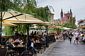 Outdoor cafes along the Ljubljanica river, Ljubljana, Slovenia, Europe