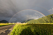 Rainbow over green fields of countryside, Cosio Valtellino, Sondrio province, Valtellina, Lombardy, Italy, Europe