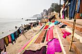 Washing drying on ghats next to the River Ganges, Varanasi, Uttar Pradesh, India, Asia