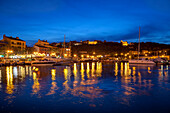 Harbour lit up at dusk, Porto Vecchio, Corsica, France, Mediterranean, Europe