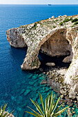 The dramatic natural arch at the Blue Grotto, Malta, Mediterranean, Europe