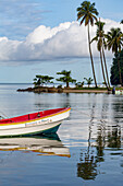 Traditional fishing boat moored at Marigot Bay with tall palms on the small beach in the distance, St. Lucia, Windward Islands, West Indies Caribbean, Central America