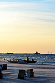 People and small wooden fishing boat on the beach of Ahlbeck, Usedom, Ostseeküste, Mecklenburg-Western Pomerania, Germany