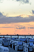 Pier with beach chairs and sunset, Ostseeküste, Mecklenburg-Western Pomerania, Germany