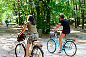 Young people are cycling in the National Park, Wollin, Baltic Sea coast, Poland
