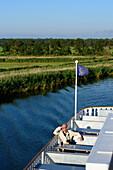 Excursion boats River Star as Mississippi steamer on the Prerower stream. Boddenlandschaft on the Darss, Ostseeküste, Mecklenburg-Western Pomerania Germany