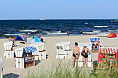 People and beach chairs on the beach, three-master in the background, Bansin, Usedom, Baltic Sea coast, Mecklenburg-Vorpommern, Germany