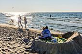 Loving couple in a sandburg at the beach of Warnemünde, Ostseeküste, Mecklenburg-Vorpommern, Germany
