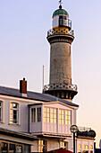 Lighthouse with house in the evening light, Warnemünde, Ostseeküste, Mecklenburg-Vorpommern, Germany