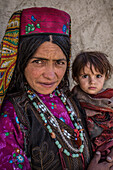 Wakhi mother with little child, Wakhan, Afghanistan, Asia