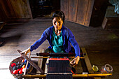 Woman makes traditional clothes in Arunachal, India, Asia