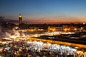 Jemaa el-Fnaa square and market place in Marrakesh at night, Morocco, Africa