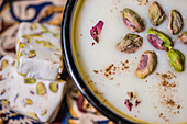 Iranian gaz and ricepudding fereni with pistachios, Iran, Asien