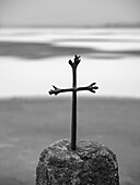 A Cross on the shore of the frozen Staffelsee, Seehausen, Upper Bavaria, Germany