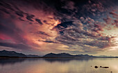 Dusk on the Chiemsee with views of the Chiemgau Alps and the Kaisergebirge, Chieming, Upper Bavaria, Germany