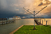 Thunderstorm atmosphere at the harbor of Gstadt with a view of the Fraueninsel and the Chiemgau Alps, Gstadt am Chiemsee, Upper Bavaria, Germany