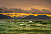 Evening mood on the stormy Chiemsee with views of the Chiemgau Alps and Kaisergebirge, Chieming, Upper Bavaria, Germany