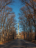 View through the trees on the Friedensdenkmal on a sunny winter day, Munich, Upper Bavaria, Germany