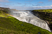 Tourists visiting iconic Gullfoss (Golden Falls), Olfusa River in southwest Iceland, Polar Regions