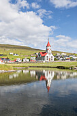 Church of Sandavagur reflected in water, Vagar Island, Faroe Islands, Denmark, Europe