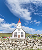 Panoramic of church and village of Sandavagur, Vagar Island, Faroe Islands, Denmark, Europe