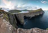 Panoramic of photographer on cliffs above lake Sorvagsvatn, Vagar Island, Faroe Islands, Denmark, Europe
